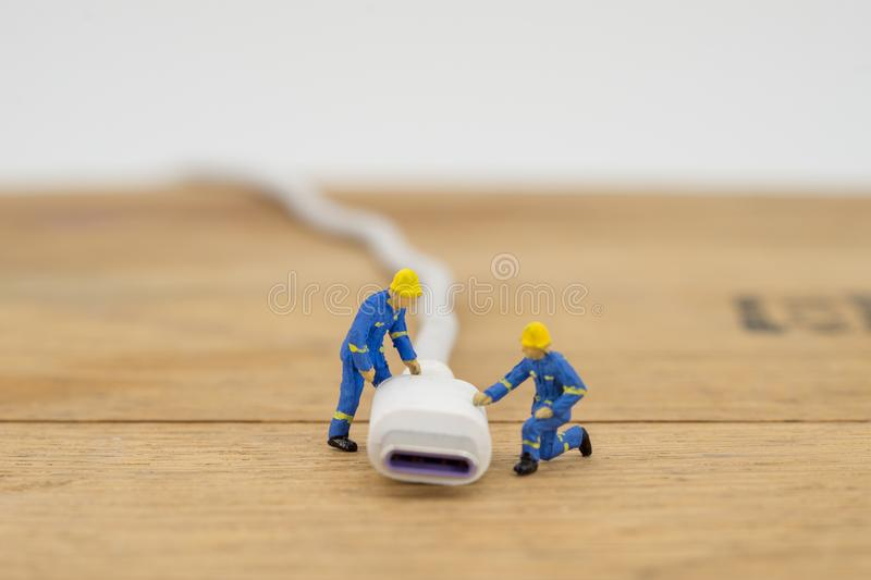 Miniature with charger plug or cable for connecting royalty free stock photography