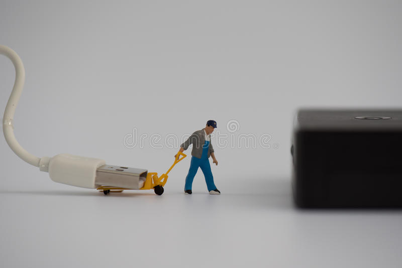 Miniature with charger plug or cable for connecting power bank royalty free stock images