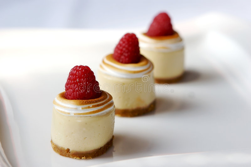 Miniature cheese cakes royalty free stock photo