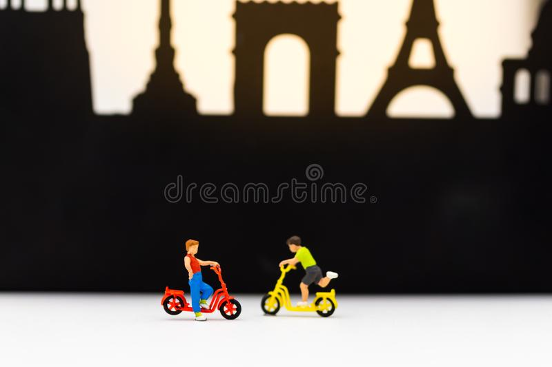 Miniature children: Boys cycling play fun in the playground. Image use for International Children`s day.  royalty free stock images