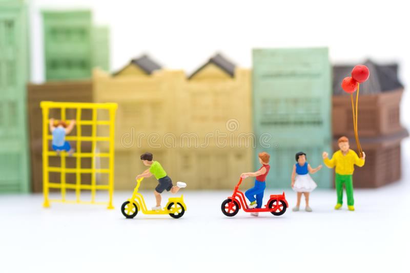 Miniature children: Boys cycling play fun in the playground. Image use for Children`s day stock photography