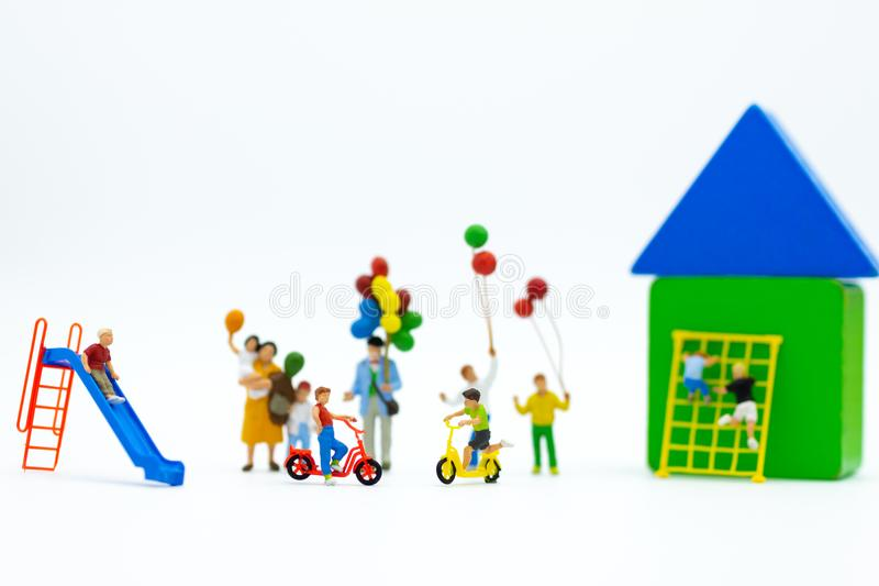 Miniature children: Group childrens are playing together on playground. Image use for Children`s Day. stock photo