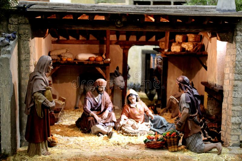Miniature Christmas nativity scene with Mary, Joseph and the baby Jesus royalty free stock photos