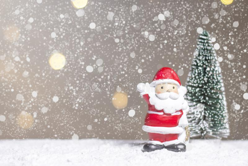 Miniature Christmas Santa cros and Tree on snow over blurred bokeh background,Decoration Image for Christmas Holiday and Happy New royalty free stock photos