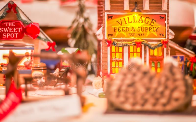 Miniature Christmas Town Scene During the Holidays. Miniature store fronts showing vintage buildings and shops during the christmas season stock photography