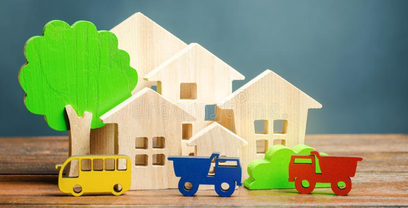 Miniature city. Children`s figures and educational games. Wooden houses, trees and vehicles. The concept of urbanization. Growth. And development of the urban royalty free stock photos