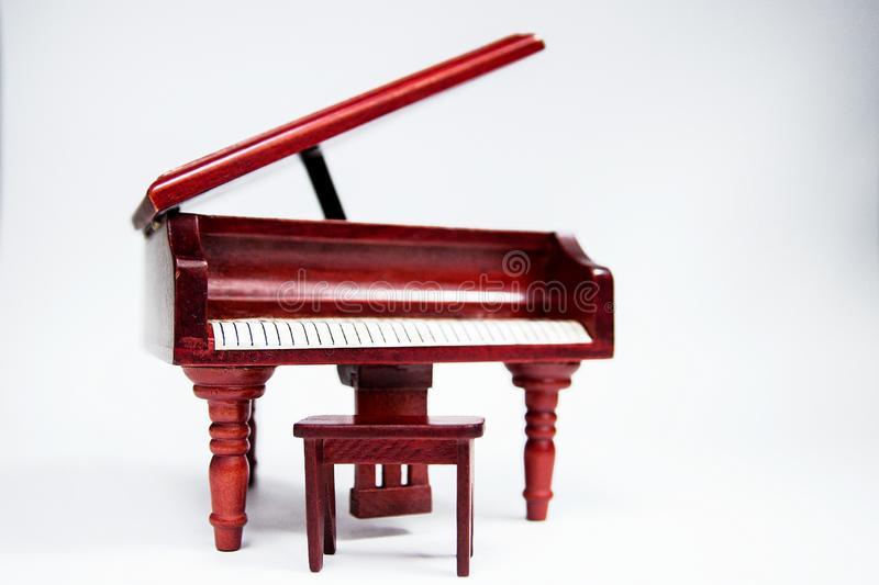Miniature classic piano keyboard instrument  on white background.  royalty free stock images