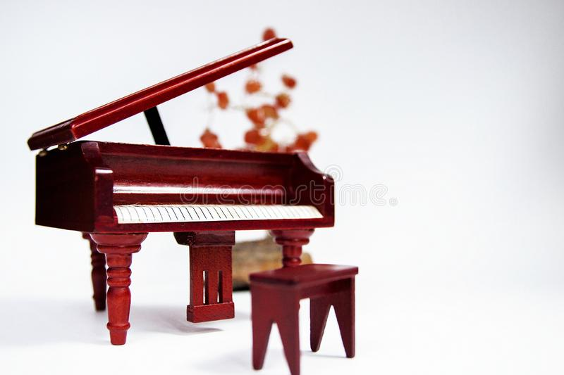 Miniature classic piano keyboard instrument isolated on white background.  royalty free stock photo