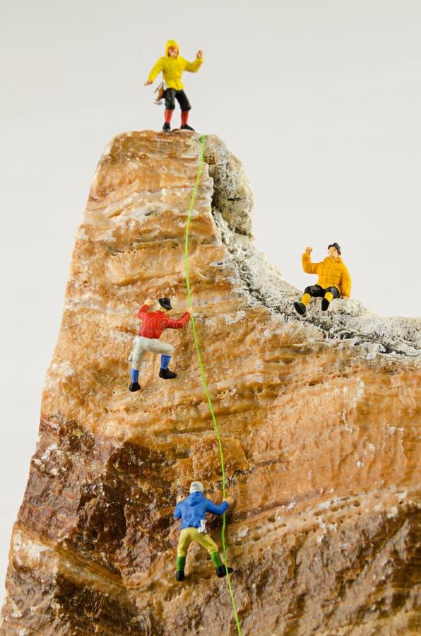 Free Miniature Climbers Climbing Rocks Royalty Free Stock Image - 87427846
