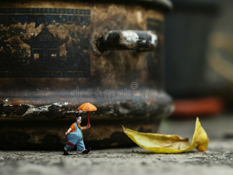 Miniature of clown walking alone stock photography