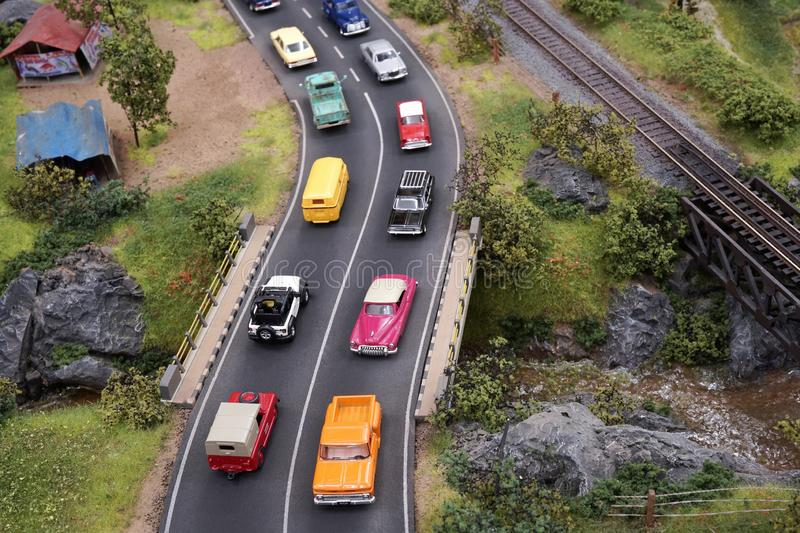 Miniature crowded roads traffic with many cars in the street. Miniature crowded roads traffic with many cars in the  street vehicle, drive, safe drive royalty free stock image
