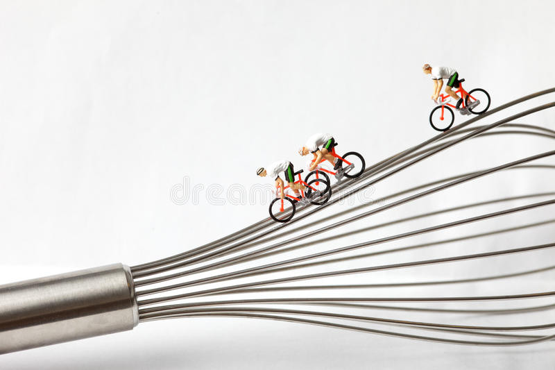 Miniature cyclist on a whisk royalty free stock image