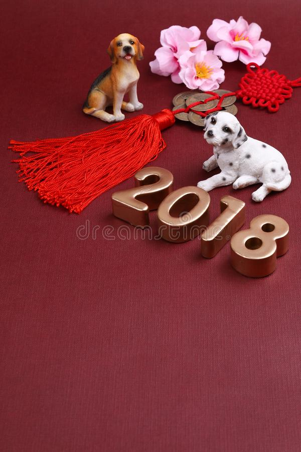 Free Miniature Dogs With Chinse New Year Decorations 2018 Stock Photos - 107238183