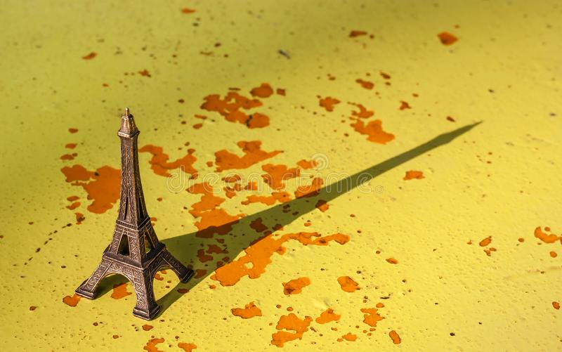 Miniature of the eiffel tower with your shadow royalty free stock photo