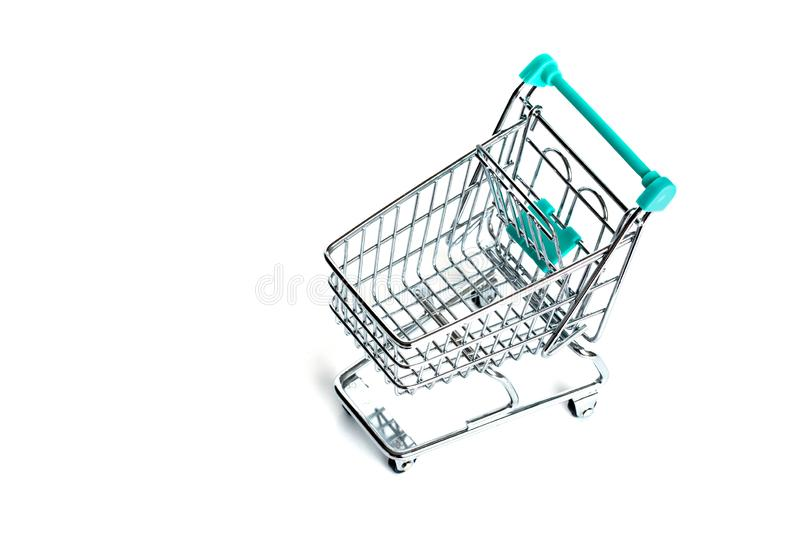 Miniature empty shopping cart turquoise color on white background. isolated. Top view, flat lay royalty free stock images