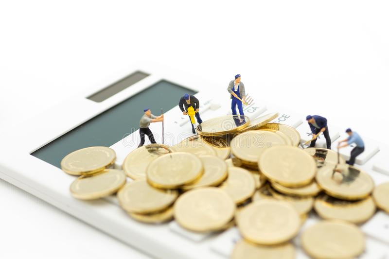 Miniature figure :Calculator for calculating money, tax, monthly/yearly. Image use for finance, business concept.  royalty free stock photography