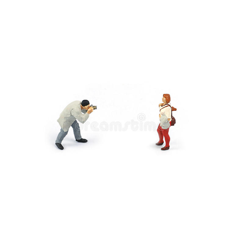 Miniature figure people , Photographer to take a photo for girl royalty free stock images