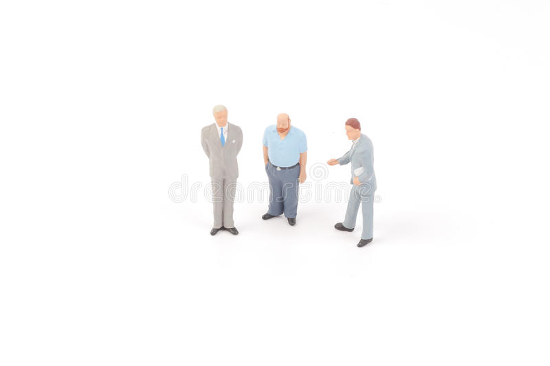 Miniature figures of business man. On back ground stock images