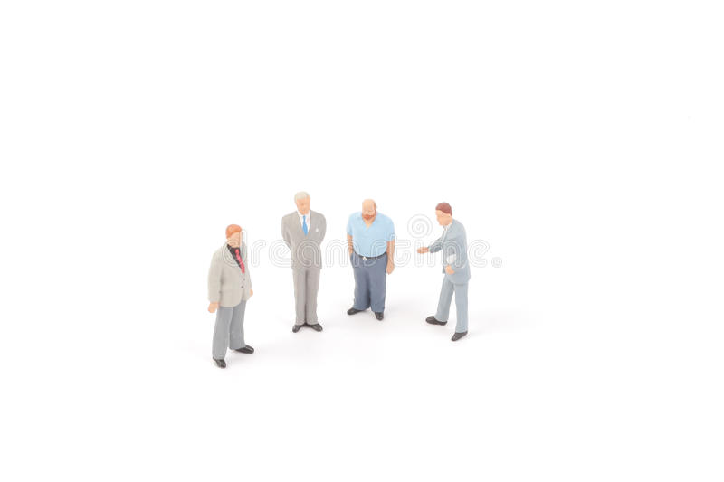 Miniature figures of business man. On back ground royalty free stock images