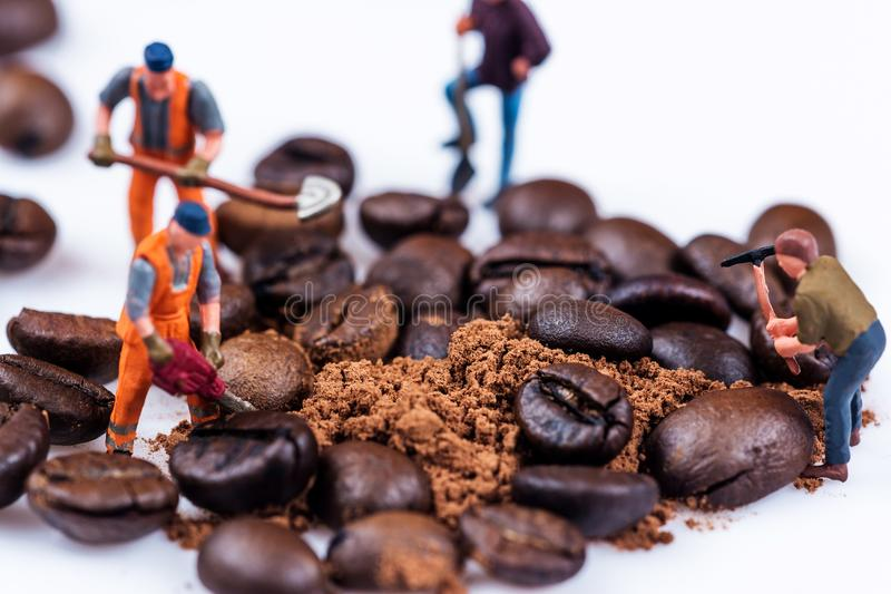 Figures working on coffee royalty free stock images