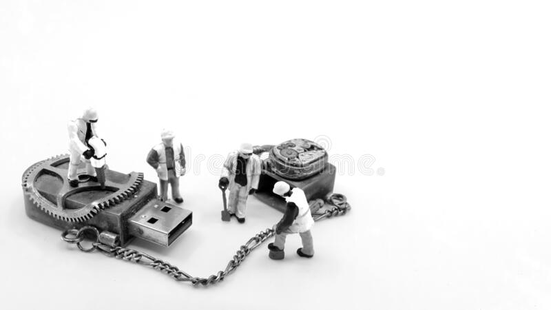 Miniature figurines with memory stick royalty free stock image