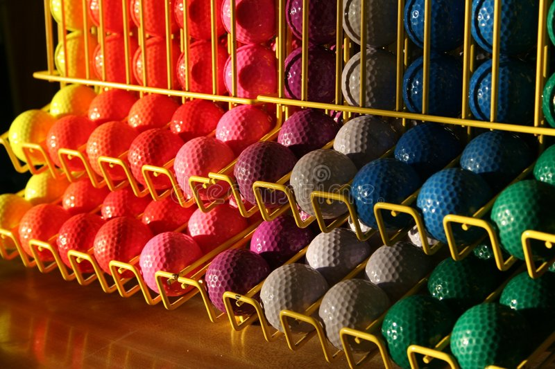 Miniature golf balls in a rack royalty free stock photography