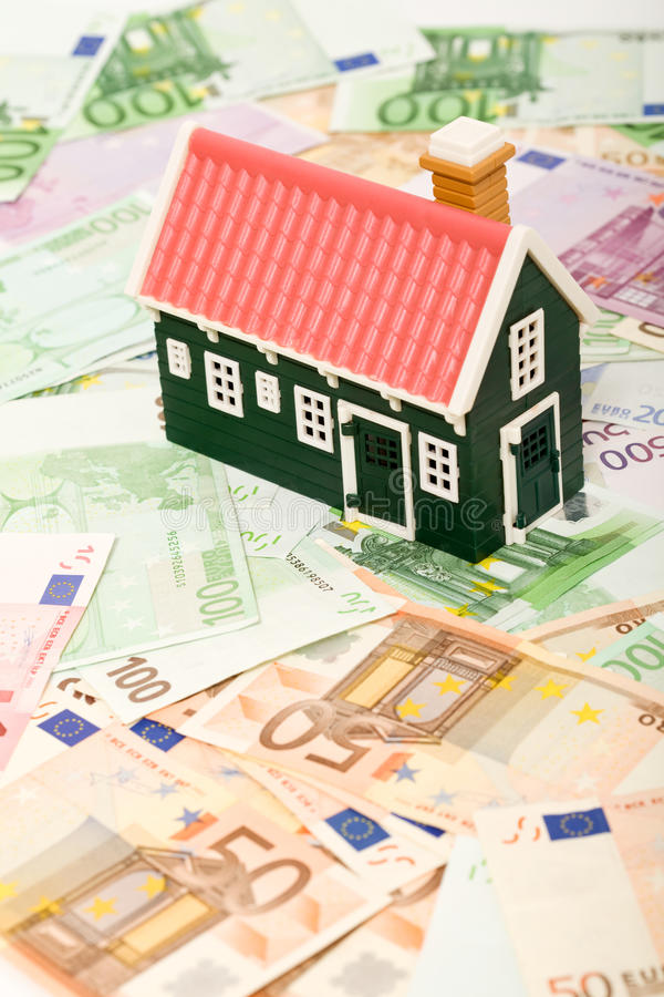Miniature house on euro banknotes field