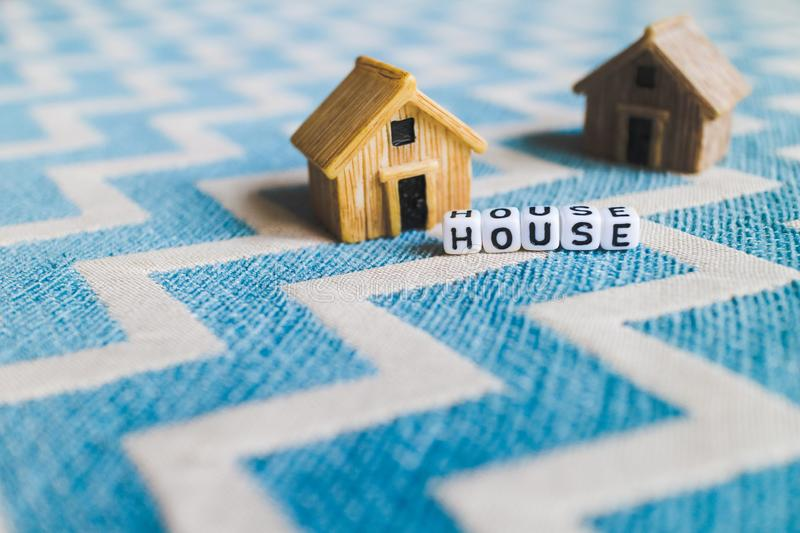 Miniature house model. With `HOUSE` alphabet cube letter royalty free stock photos