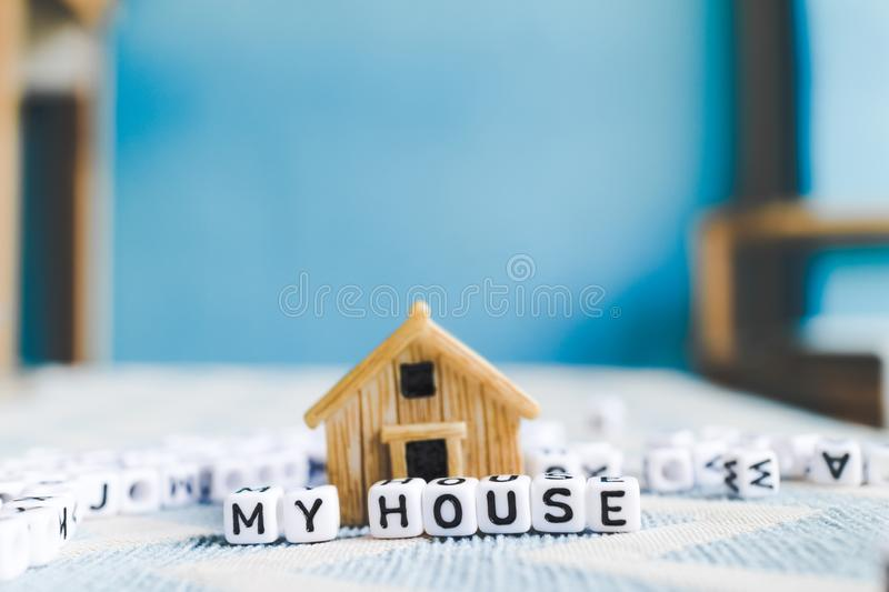 Miniature house model. With `HOUSE` alphabet cube letter stock photo
