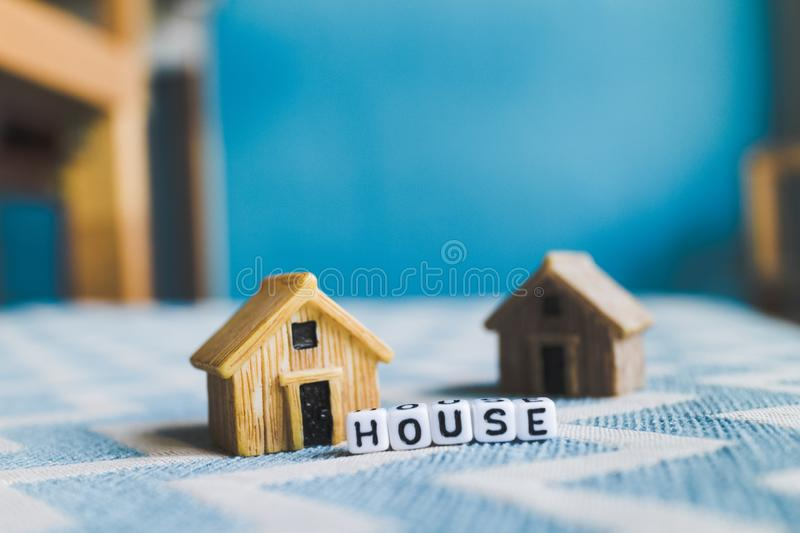 Miniature house model. With `HOUSE` alphabet cube letter royalty free stock photo