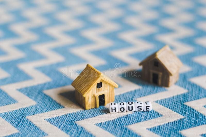 Miniature house model. With `HOUSE` alphabet cube letter stock image