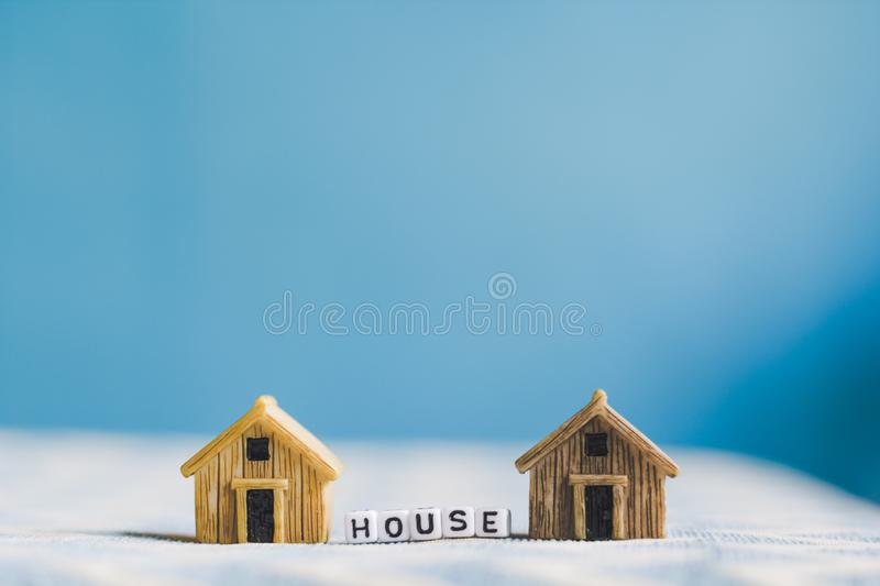 Miniature house model. With `HOUSE` alphabet cube letter stock photography