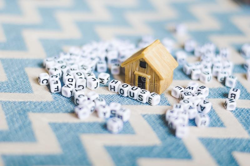 Miniature house model. With `HOUSE` alphabet cube letter stock images