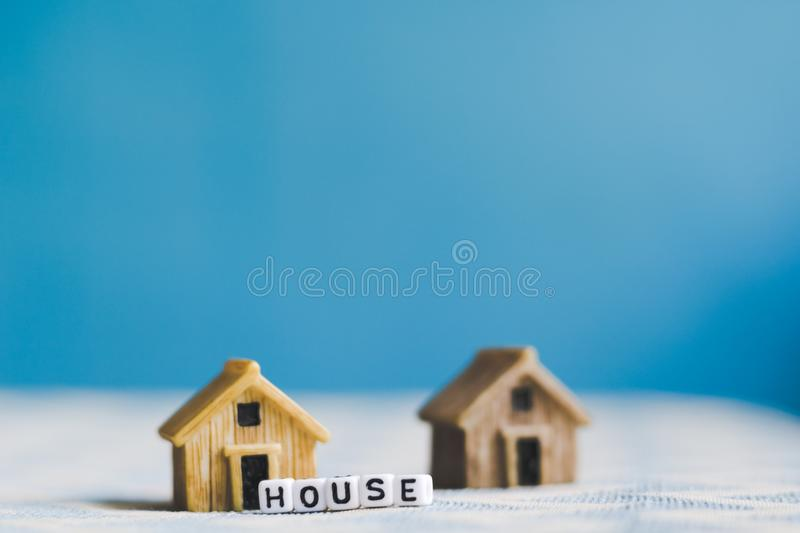 Miniature house model with. `HOUSE` alphabet cube letter royalty free stock image