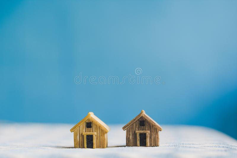 Miniature house model with. `HOUSE` alphabet cube letter royalty free stock images