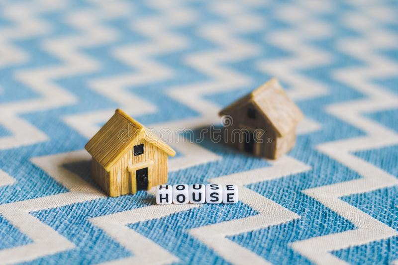 Miniature house model with. `HOUSE` alphabet cube letter stock image