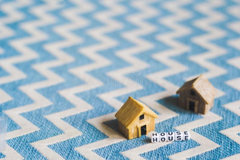 Miniature house model. With `HOUSE` alphabet cube letter royalty free stock photography
