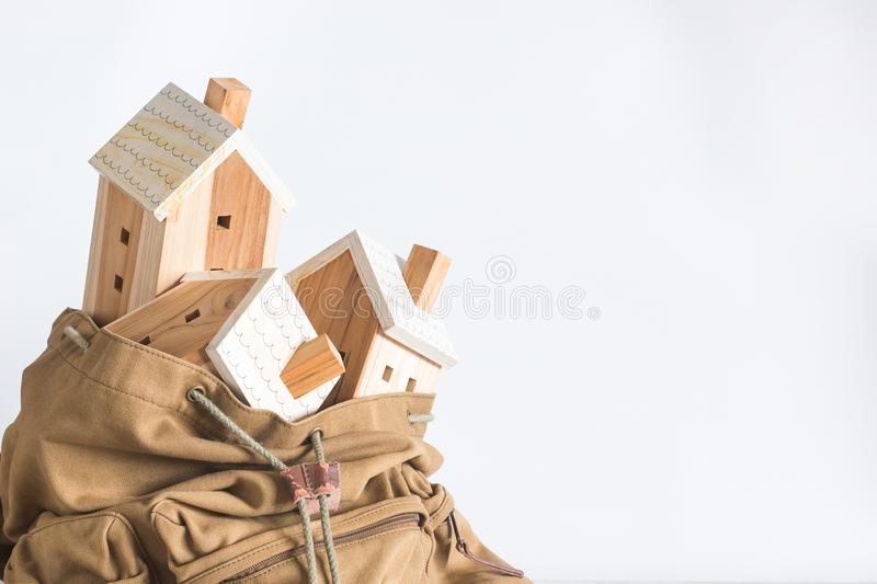 Miniature house model in the brown color Backpack on white background royalty free stock photography