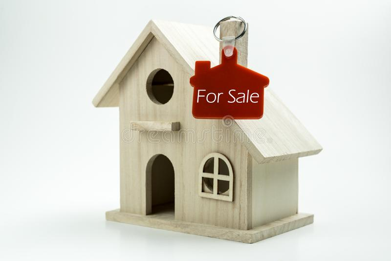 House for sale sign. Miniature house model with for sale keychain label royalty free stock images