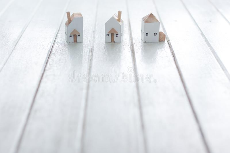Miniature house model on white wood. Background, copy space stock image