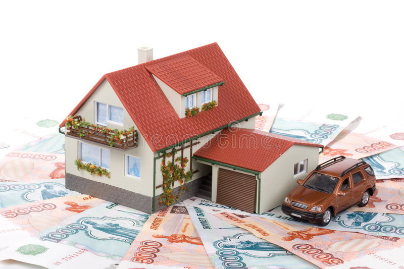 Miniature House and Money. Buying house concept royalty free stock photos