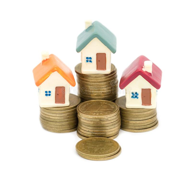 Miniature house on stack coins using as property and business concep, isolated on white background, business house investment. Ideas concept with coin money royalty free stock photo