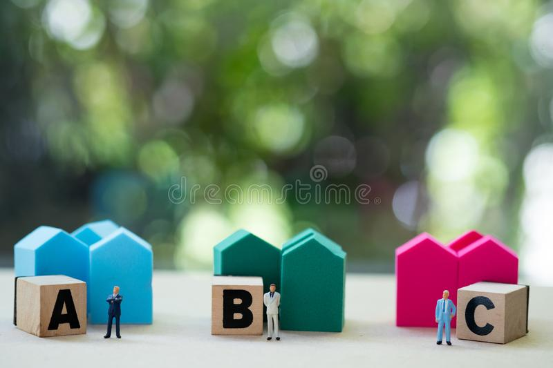 Miniature investment broker or bank worker three bank offer loan for customers. Miniature people : investment broker or bank worker three bank offer loan for royalty free stock photos