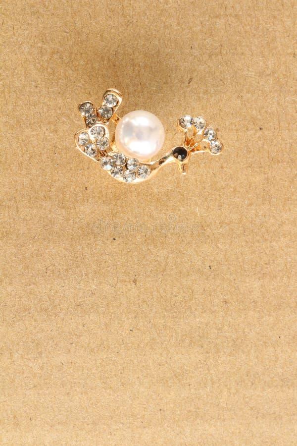 Miniature jewelry on cardboard royalty free stock image