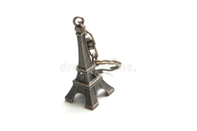 Miniature métallique de Tour Eiffel sur le fond blanc image stock