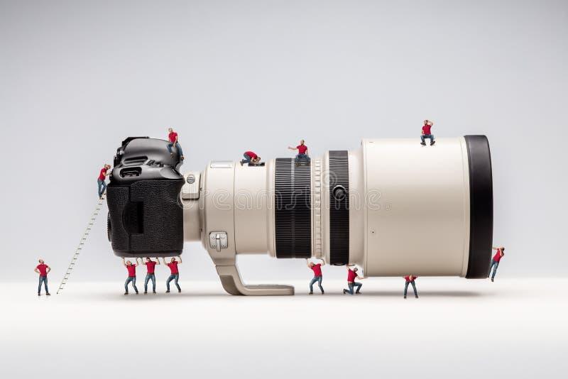 Miniature man and camera. Macro photo royalty free stock photos