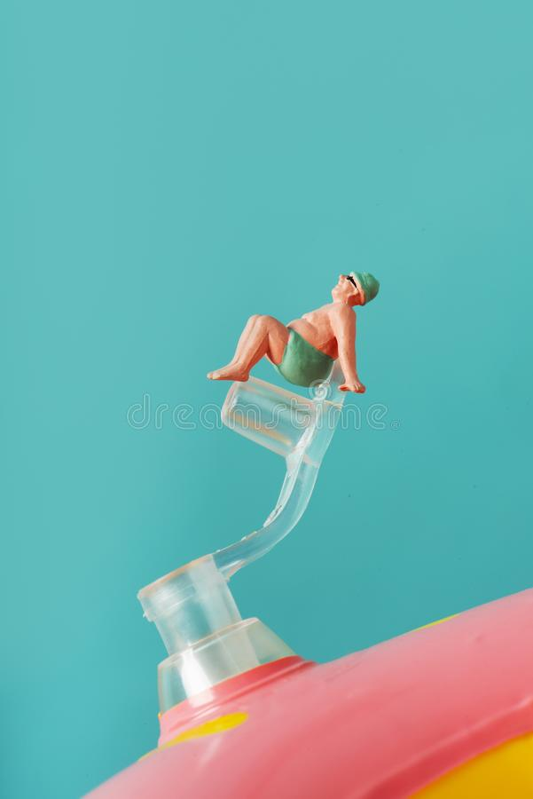 Miniature man in swimsuit royalty free stock photography