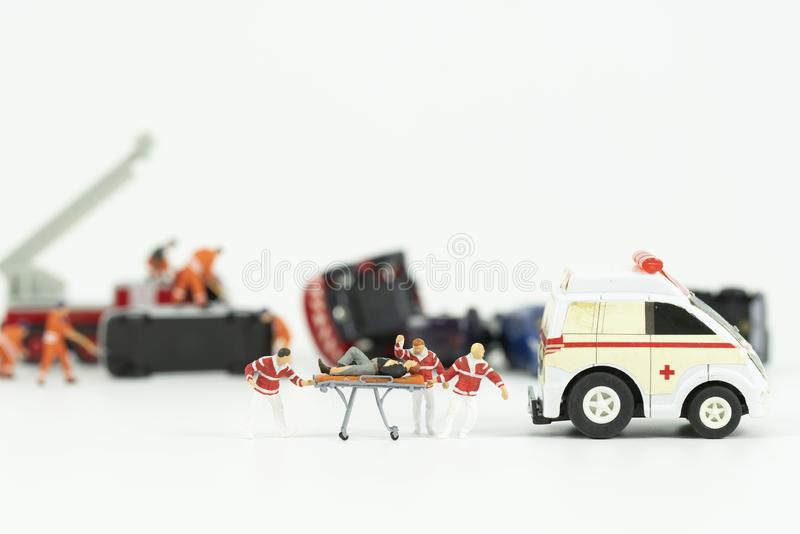 Miniature medical team work at car accident scene stock photo