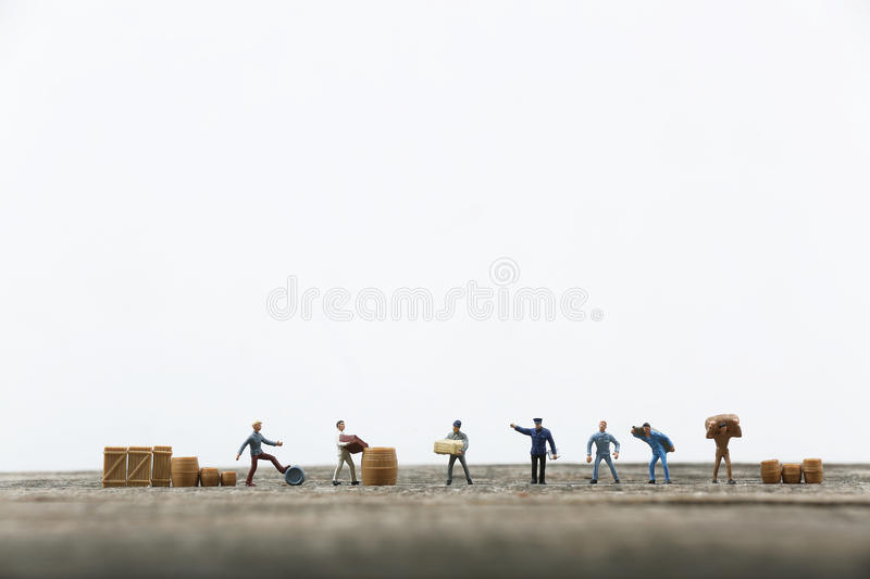 Miniature men working. In a line, product life cycle stock photos