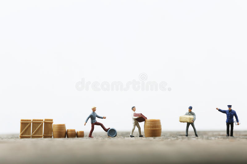 Miniature men working. In a line, product life cycle stock photo